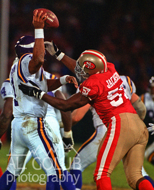 San Francisco 49ers vs. Minnesota Vikings at Candlestick Park Monday, December 18, 1995.  49ers beat Vikings  37-30.  San Francisco 49ers linebacker Rickey Jackson (57) sacks Minnesota Vikings quarterback Warren Moon (1).