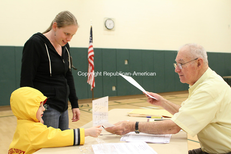 WATERTOWN, CT-15 May 2012-051512LW01- Anthony Desantis, 4, and his mother, Kate Desantis check in with ballot clerkTony DiPrimo at Swift Middle School to vote in the budget referendum Tuesday. Both the town and school budgets passed. Laraine Weschler Republican-American
