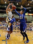 BROOKINGS, SD - NOVEMBER 18:  Megan Waytashek #24 from South Dakota State University has the ball knocked from her hands by Marissa Janning #23 from Creighton in the first half of their game Tuesday night at Frost Arena in Brookings. (Photo by Dave Eggen/Inertia)