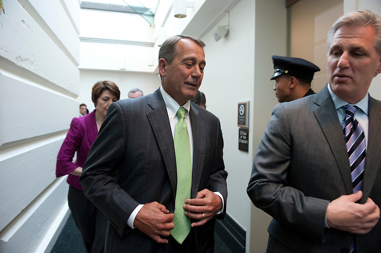 UNITED STATES - JULY 12: House Speaker John Boehner, R-Ohio; and House Majority Whip Kevin McCarthy,  R-Calif., walk to the media availability following a closed GOP conference meeting in the U.S. Capitol. (Photo By Douglas Graham/Roll Call)