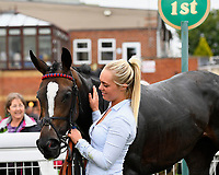 Love and Be Loved with stable Lass in the winners enclosure during Afternoon Racing at Salisbury Racecourse on 7th August 2017