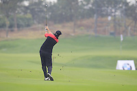 David Howell (ENG) plays his 3rd shot on the 3rd hole during Thursday's Round 1 of the 2014 BMW Masters held at Lake Malaren, Shanghai, China 30th October 2014.<br /> Picture: Eoin Clarke www.golffile.ie