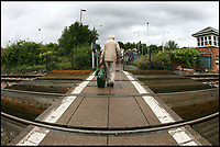 BNPS.co.uk (01202 558833)<br /> Pic: RichardCrease/BNPS<br /> <br /> The current ground crossing at Wareham.<br /> <br /> Actor Edward Fox has branded an 'unsightly' rail crossing planned for his home town as a bridge too far.<br /> <br /> Mr Fox, 80, used his theatrical skills to stand up in front of 250 people at a public meeting to voice his objection at the new ramped bridge for Wareham train station in Dorset.<br /> <br /> The star of the classic World War Two film A Bridge Too Far (1977) believes the 19ft high structure would be a blot on the landscape of the smart market town.<br /> <br /> The Grade II listed railway station is currently served by a level crossing which is controlled by locked gates and a security guard.<br /> <br /> But Network Rail claims the existing crossing is a health and safety risk to the public.