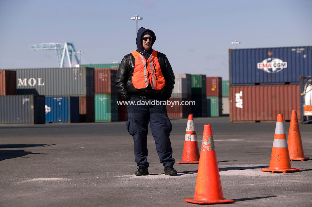 24 February 2006 - Newark, NJ - Customs and Border Protection officer Eddie Ramos watches control operations in the Port of Newark Container Terminal in Newark, USA, 24 February 2006.
