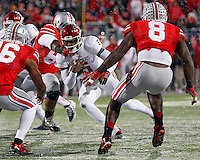Ohio State Buckeyes defensive lineman Steve Miller (88) takes down Indiana Hoosiers quarterback Tre Roberson (5) during the fourth quarter of their college football game at Ohio Stadium in Columbus, Ohio on November 23, 2013.  (Dispatch photo by Kyle Robertson)