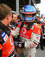 Jamie Whincup is congratulated by his pit crew after winning Race Two during Day Three of the Hamilton 400 Aussie V8 Supercars Round Two at Frankton, Hamilton, New Zealand on Sunday, 19 April 2009. Photo: Dave Lintott / lintottphoto.co.nz