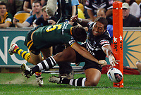 Manu Vatuvei just drops the ball as he is tackled into touch during the Rugby League World Cup final between the Australian Kangaroos and the New Zealand Kiwis at Suncorp Stadium, Brisbane, Australia. Saturday 22 November 2008. The Kiwis won the match 34-30..Pic: Andrew Cornaga/PHOTOSPORT