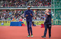high jump champion Essa Mutaz BARSHIM of Qatar is guided into position for Photographers by a media team assistant during the Muller Grand Prix Birmingham Athletics at Alexandra Stadium, Birmingham, England on 20 August 2017. Photo by Andy Rowland.