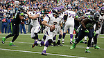 Minnesota Vikings quarterback Christian Ponder scrambles out of the end zone against the Seattle Seahawks at CenturyLink Field in Seattle, Washington on  November 4, 2012.  Ponder completed 11 of 22 passes for 64 yards, was sacked four times and  had one pass intercepted in the Vikings 20-30 loss to the Seahawks.   ©2012. Jim Bryant Photo. All Rights Reserved.