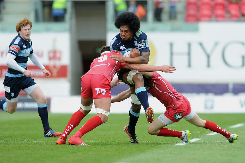 Cardiff Blues' Filo Paulo is tackled by Scarlets' Lewis Rawlins<br /> <br /> Photographer Ian Cook/CameraSport<br /> <br /> Rugby Union - Guinness PRO12 - Scarlets v Cardiff Blues - Sunday 10th May 2015 - Parc y Scarlets - Llanelli<br /> <br /> &copy; CameraSport - 43 Linden Ave. Countesthorpe. Leicester. England. LE8 5PG - Tel: +44 (0) 116 277 4147 - admin@camerasport.com - www.camerasport.com
