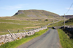 Road and dry stonewalls, Pen Y Ghent, Yorkshire Dales national park, England, UK