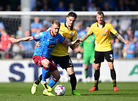 Scunthorpe United's Paddy Madden shields the ball from Bolton Wanderers' Dorian Dervite<br /> <br /> Photographer Chris Vaughan/CameraSport<br /> <br /> The EFL Sky Bet League One - Scunthorpe United v Bolton Wanderers - Saturday 8th April 2017 - Glanford Park - Scunthorpe<br /> <br /> World Copyright &copy; 2017 CameraSport. All rights reserved. 43 Linden Ave. Countesthorpe. Leicester. England. LE8 5PG - Tel: +44 (0) 116 277 4147 - admin@camerasport.com - www.camerasport.com