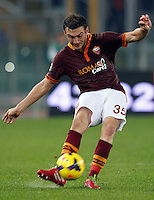Calcio, Serie A: Roma vs ChievoVerona. Roma, stadio Olimpico, 31 ottobre 2013.<br /> AS Roma defender Vasilis Torosidis, of Greece, kicks the ball during the Italian Serie A football match between AS Roma and ChievoVerona at Rome's Olympic stadium, 31 October 2013.<br /> UPDATE IMAGES PRESS/Riccardo De Luca