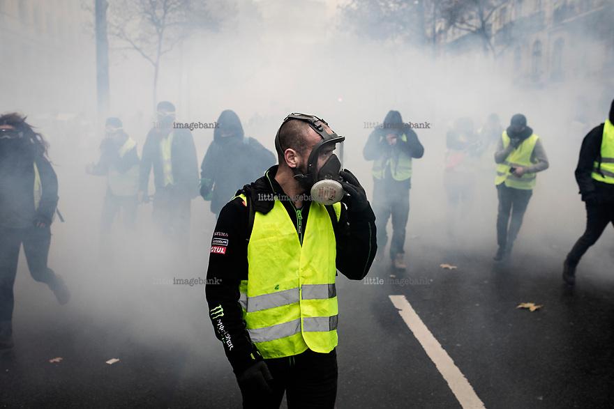 Paris, Frankrike, 01.12.2018. Gilets jaunes, de gule vestene mobiliserer i Frankrike mot Emanuel Macrons usosiale politikk. Foto: Christopher Olssøn.
