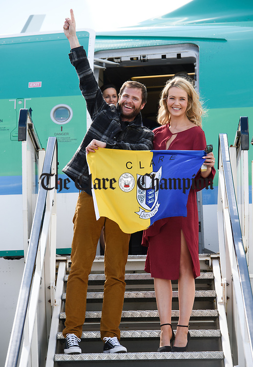 Spanish Point man John Burke, accompanied by his wife Aoibhin Garrihy, flies the saffron and blue on his arrival back to Shannon Airport, following his successful attempt, being the first Clare person ever to climb Mount Everest. Photograph by John Kelly.