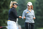 Megan Grehan (left) exchangesa  golf ball hat clip marker with Anya Alvarez (right) on the 1st hole at the LPGA Championship 2014 Sponsored By Wegmans at Monroe Golf Club in Pittsford, New York on August 13, 2014