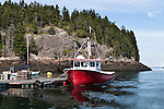 Red Fishing Boat moored to a dock in Head Harbor, Campobello Island, New Brunswick, Canada