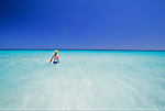 Girl on beach at Great Guana Cay, Abacos, Bahamas