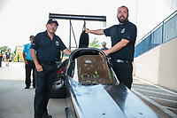 May 31, 2019; Joliet, IL, USA; Mike Salinas and crew member with NHRA top alcohol dragster driver Jasmine Salinas during qualifying for the Route 66 Nationals at Route 66 Raceway. Mandatory Credit: Mark J. Rebilas-USA TODAY Sports