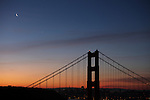 The crescent moon and the Venus was tuck close together over the Golden Gate Bridge during the morning twilight in San Francisco as seen from the Marin Headlands.......