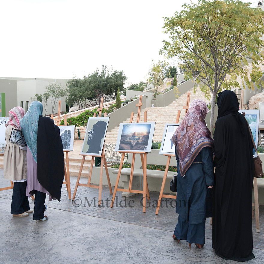 Lebanese ladies  looking at an Art exhibit in Mleeta. Mleeta tourist landmark of the resistance in Lebanon is a natural museum, which inventively displays the Israeli spoils of war and the resistance weapons in open air on a land of 60,000 m2 of gardens and woods with 5,000 m2 of buildings.It is formed of several sections with outstanding architecture that combines the landmark with natural woods and a large cave. These sections vary from each other in order to portray the story of the resistance against the Israeli enemy in different shapes. The visitor will be aquatinted closely with the methods that the resistance employed to produce liberation in 2000 and victory in 2006.