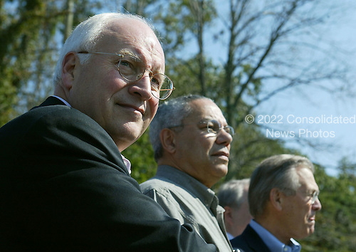 Left to right: United States Vice President Dick Cheney, Secretary of State Colin Powell and Secretary of Defense Donald Rumsfeld listen to United States President George W. Bush and President Vladimir Putin of Russia speak during a news conference September 27, 2003 at Camp David, Maryland. Putin arrived September 26 after attending official meetings at the United Nations in New York.  .Credit: Mark Wilson - Pool via CNP..