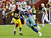 Dallas Cowboys tight end Jason Witten (82) carries the ball after a reception against the Washington Redskins at FedEx Field in Landover, Maryland on Sunday, September 12, 2010.  Redskins cornerback Carlos Rogers (22) gives chase.  The Redskins won the game 13 - 7. .Credit: Ron Sachs / CNP