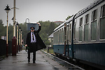© Joel Goodman - 07973 332324 . 24/05/2014 . Heywood Station , Railway Street , Heywood, UK . Time for the train to leave . 1940s weekend on the East Lancs Railway , with visitors dressed up and partaking in 40s-themed events . Photo credit : Joel Goodman