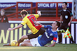 Lee Wallace booked for a tackle from behind on Steven Lawless