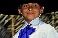 Portrait of a smiling Mexican boy with a big black hat and blue tie at a folk dance foto, reise, photograph, image, images, photo,<br /> photos, photography, picture, pictures, urlaub, viaje, vacation, imagen, viagi, stock