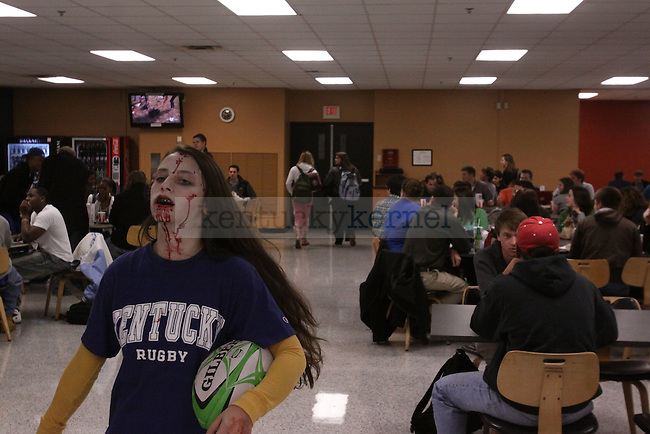 Theatre senior Sara Macy walks around the Student Center Cafeteria as a zombie scaring and amusing UK students on Wednesday. Photo by Scott Hannigan | Staff