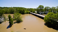 Flooding is pictured along the White River at Cooper's Commons park in Spencer, Indiana on Sunday, May 7, 2017. The Old Ellettsville Road bridge is pictured at right. (Photo by James Brosher)