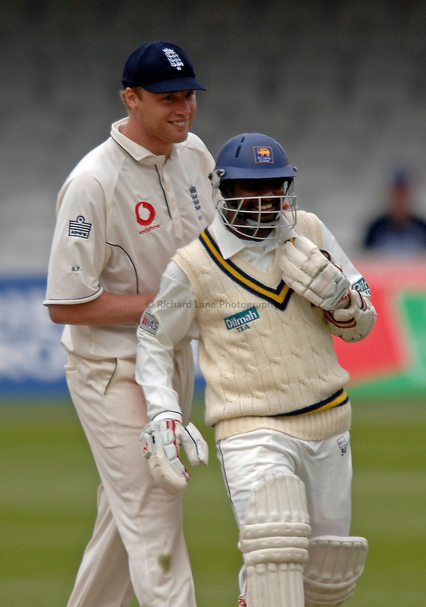 Photo: Glyn Thomas..England v Sri Lanka. nPower Test Match Series. 15/05/2006..Sri Lanka's Muttiah Muralitharan (R) shares a joke with Andrew Flintoff.