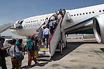 Passengers boarding Oman Airways plane, Seeb International Airport, Muscat, Oman
