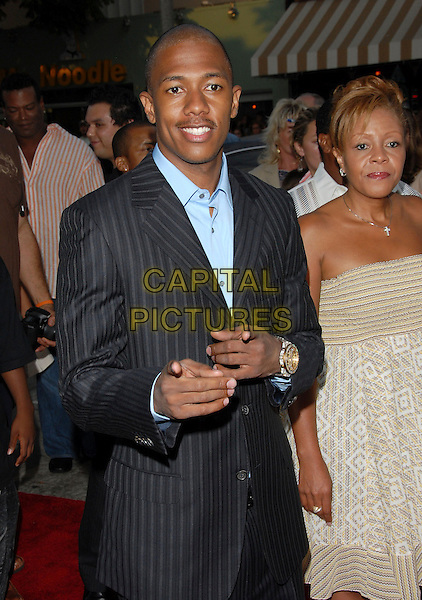 """NICK CANNON.World Premiere of """"Monster House"""" held at The Mann's Village Theatre in Westwood, California, USA..July 17th, 2006.Ref: DVS.half length grey gray pinstripe suit jacket pointing.www.capitalpictures.com.sales@capitalpictures.com.Supplied By Capital PIctures"""