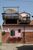 Small colourful house on Burana, Venice lagoon with balustraded deck added to roof, Venice, Italy, May 2007,