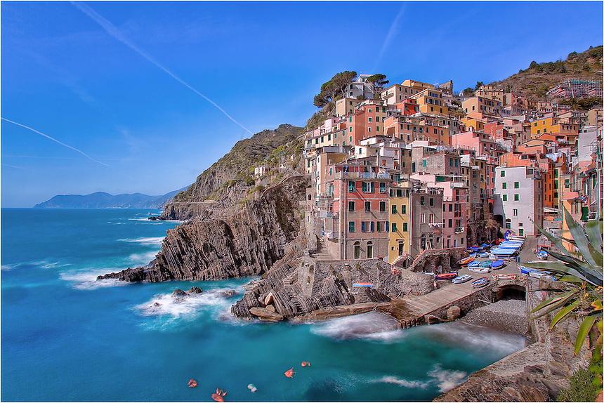 Afternoon in the Cinque Terre is a great place to grab a sandwich and some wine, find a bench along the rocky coast, and enjoy the scenery. Here, I found a nice view looking at Riomaggiore and I simply enjoyed watching the world go by.