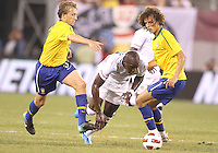 Jozy Altidore #17 of the USA cuts between David Luiz #4 and Lucas #5 of Brazil during an international friendly matchl in Giants Stadium, on August 10 2010, in East Rutherford, New Jersey.Brazil won 2-0.