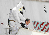 Operazione Mare Nostrum , immigrati in scendono al porto di Napoli dalla nave Virginio Fasan, impiegata nell operazione Mare Nostrum <br /> la felicita di un bambino sulla passerellaMigrants  disembark in Naples Harbour <br />  from the ship &quot;Virginio Fasan&quot; of the Italian navy,  the  vessel involved in search-and-rescue operations the ship is engaged in the rescue operation &quot;Mare Nostrum&quot; in the Mediterranean Sea