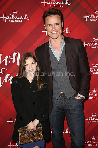 LOS ANGELES, CA - DECEMBER 4: Dylan Neal, daughter Bella Neal, at Screening Of Hallmark Channel's 'Christmas At Holly Lodge' at The Grove in Los Angeles, California on December 4, 2017. Credit: Faye Sadou/MediaPunch