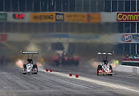 Apr 26, 2015; Baytown, TX, USA; NHRA top fuel driver Larry Dixon (left) races alongside Doug Kalitta during the Spring Nationals at Royal Purple Raceway. Mandatory Credit: Mark J. Rebilas-