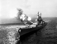 A 16-inche salvo from the USS Missouri at Chong Jin, Korea, in effort to cut Northern Korean communications.  Chong Jin is only 39 miles from the border of China.  October 21, 1950.  (Navy)<br /> NARA FILE #:  080-G-421049<br /> WAR &amp; CONFLICT BOOK #:  1444