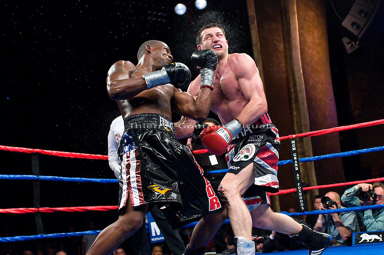 Mashatucket, Connecticut - April 25, 2009: Jermain Taylor on the attack against  Carl Froch during their WBC super middleweight championship fight at the MGM Grand at the Foxwoods casino. Froch won by TKO in the twelve round, stopping Taylor 14 seconds before the end of the fight and retained his WBC championship belt. Photo by Thierry Gourjon.