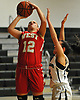 Alexa Hinke #12 of Half Hollow Hills West, left, draws a foul during the Russ Tietjen Invitational final against host Harborfields High School on Friday, Dec. 1, 2017. Hills West won by a score of 61-54.