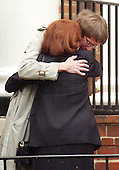 """Arlington, VA - October 21, 2002 -- Unidentified mourners hug following the funeral of Linda Franklin at Mount Olivet United Methodist Church, in Arlington, VA on 21 October, 2002.  Ms. Franklin was shot and killed by the """"Beltway Sniper"""" last Monday as she shopped at the Home Depot in the Seven Corners Shopping Center.<br /> Credit: Ron Sachs / CNP<br /> (RESTRICTION: NO New York or New Jersey Newspapers or newspapers within a 75 mile radius of New York City)"""