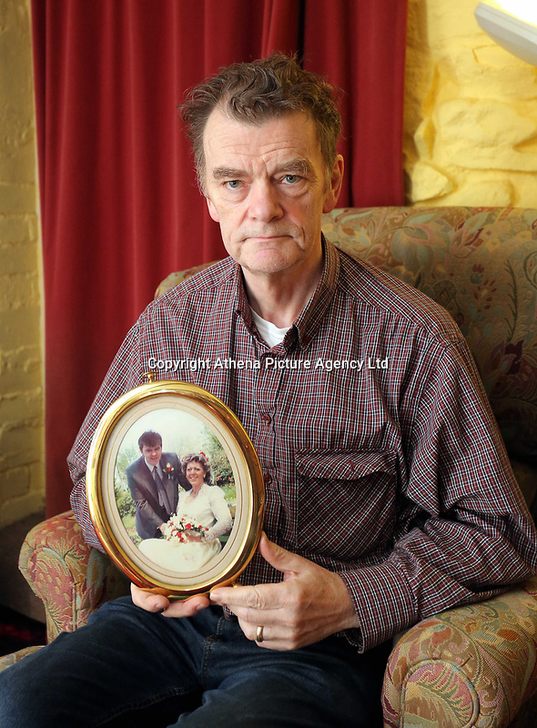 COPY BY TOM BEDFORD<br />Pictured: Howard Denby holding a picture of the wedding to his late wife Carole<br />Re: Carmarthenshire Coroner's Inquest into the death of 63 year old Carole Denby, who died after an agonising eight years living with a rogue piece of metal in her leg.<br />Denby from Llanelli, Wales, was only proved right that there was a piece of metal in her ankle after she was cremated.<br />She had broken her left ankle in 2006, but attempts to repair it were unsuccessful after numerous operations.<br />Her widower, Howard, is demanding answers as to how his wife's medics had failed to find a two-inch titanium surgical screw, which he believes led to his wife's continuing and unbearable agony , and eventually, he says, her death.