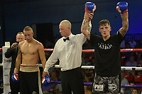 George Lamport (grey shorts) defeats Edvinas Puplauskas during a Boxing Show at Bracknell Leisure Centre on 8th July 2018