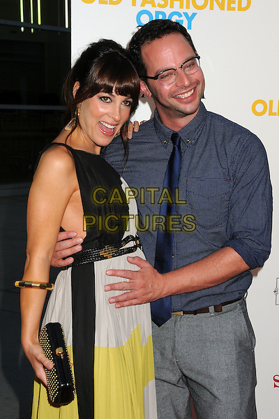 """Lindsay Sloane & Nick Kroll.""""A Good Old Fashioned Orgy"""" Los Angeles Special Screening held at Arclight Cinemas, Hollywood, California, USA..August 25th, 2011.half length black white yellow dress pregnant clutch bag maternity sleeveless blue shirt glasses hand on stomach .CAP/ADM/BP.©Byron Purvis/AdMedia/Capital Pictures."""