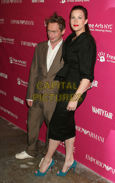 ROYSTON LANGDON & LIV TYLER.The 7th annual Free Arts NYC Art + Photography benefit auction at Phillips de Pury, New York, New York, USA..May 23rd, 2006.Ref: IW.full length married husband wife blue peep toe shoes black skirt jacket brown suit.www.capitalpictures.com.sales@capitalpictures.com.©Capital Pictures