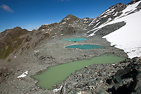 Glacial tarns along stage 6 of the Walker's Haute Route, between Cabane du Mont Fort and Cabane du Prafleuri, Switzerland.